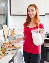 Woman making scrambled eggs with milk
