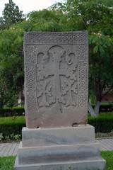 Old grey khachkar with several crosses, Yerevan