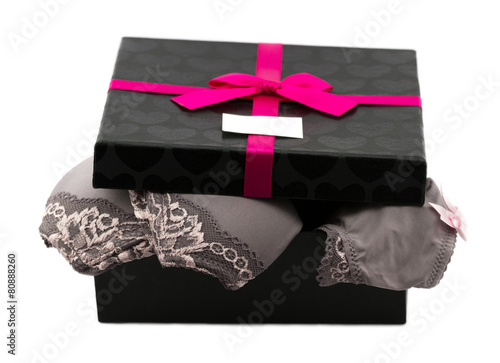 Woman lace lingerie in gift box decorated pink ribbon with bow - 80888260