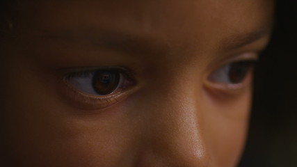 Eyes of a young child focused on something