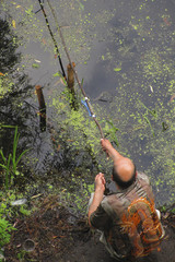 the angler-amateur with a homemade fishing rod on the shore of t