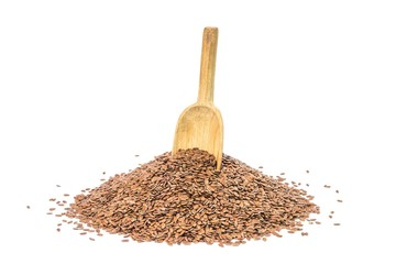 Pile of linseed with a wood spoon on white background