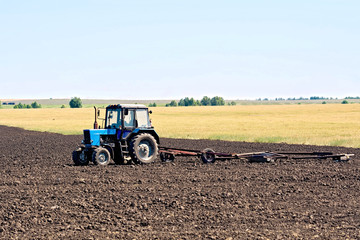 Tractor wheeled plowing