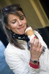 Woman licking ice cream cone