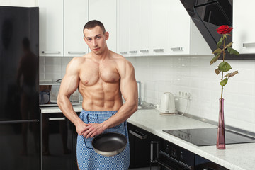 Man in an apron with a frying pan.