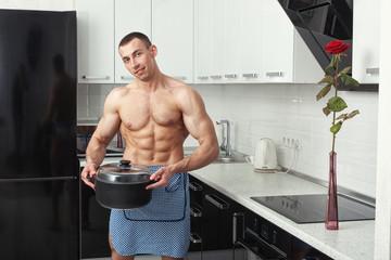 Man with a saucepan.