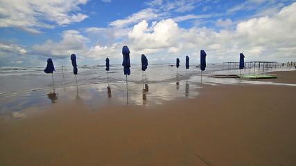 Sea coast beach wave tide surf seashore ocean umbrella