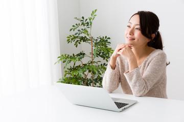young asian woman using laptop