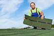 Man installing bitumen roof shingles