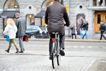 Man on bike in rain