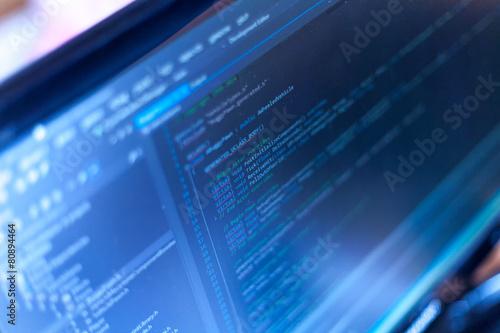 Leinwanddruck Bild Programming code on a monitor.