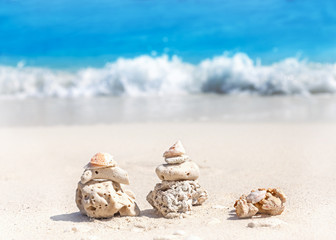Coral pyramids on beach, Zen spa concept background.