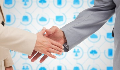 Close up of business people shaking their hands