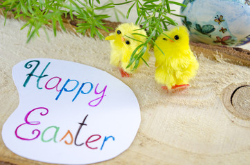 Two little yellow chickens and a Happy Easter card