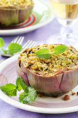 Vegetarian stuffed artichokes decorated with fresh mint