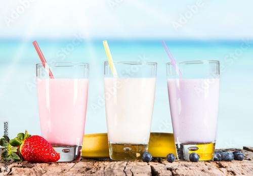 Leinwandbild Motiv Fresh milk, strawberry, blueberry and banana drinks on wodeen ta