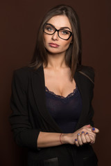 business woman in glasses and a black suit