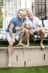 Happy handsome gay couple having fun outdoors together