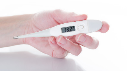Woman's hand  holding thermometer indicating a high temperature