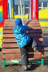 Active little boy on playground