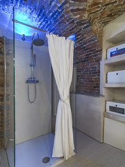 modern shower cubicle in the rustic bathroom