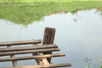 Old wooden bridge on the lake