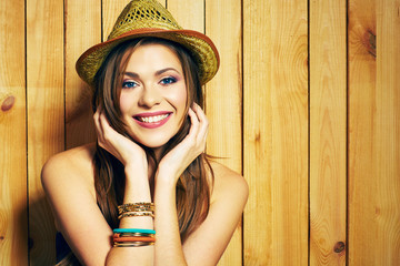 Portrait of young woman with big toothy smile.