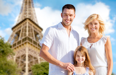 happy family in paris over eiffel tower background