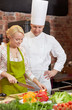 happy male chef cook with woman cooking in kitchen