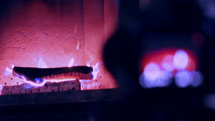 Cute home fireplace video shooting process with DSLR camera