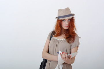 redhead girl in the hat makes the entry in the folder