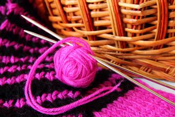 Ball of yarn and knitting needles.