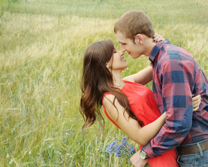 sensual outdoor portrait of young attractive couple in love kiss
