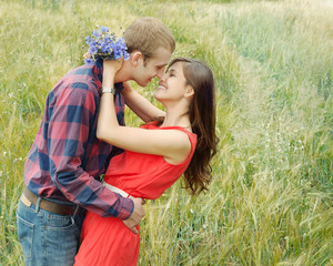 sensual outdoor portrait of young smiling attractive couple in l