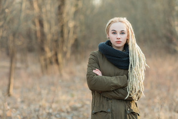 Young blonde hipster woman dreadlocks hairstyle cold season