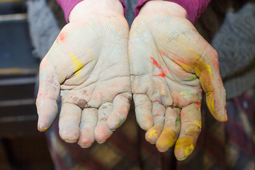 Hands stained with clay and paint. Hands painter and sculptor. C