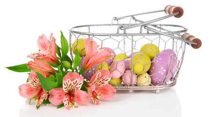 Easter composition with Easter eggs in basket and flowers,