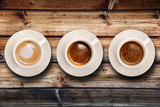 tris di caffè su fondo legno poster