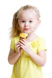 happy kid eating ice-cream in studio isolated