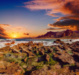 sunset at coast of the sea with stones
