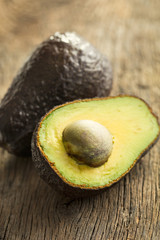 halved avocado on old table