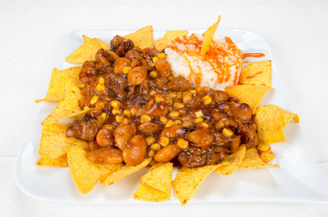 Dish of chips, beans, corn and rice.