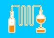 Orange distillation kit on blue background