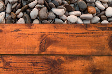 Wood bridge and sea pebbles beach background with space for text