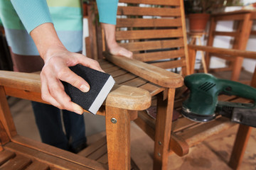 Sanding and painting an outdoor bench
