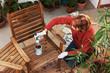 Leinwandbild Motiv Sanding and painting an outdoor bench