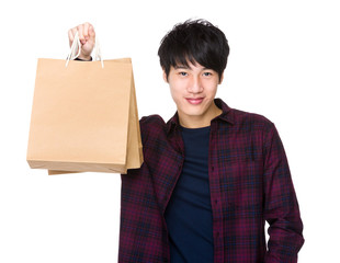 Happy Asian man shopper holding shopping bag
