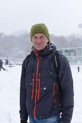 Man in a city  snow park