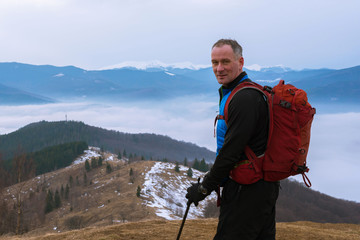 Backpacker above the clouds