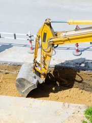 Yellow Excavator at Road Construction